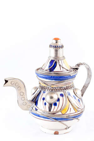 Ancient arabic ornamental teapot on white background photo