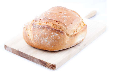 Hogaza  Spanish bread, similar to bread boule  over a kitchen cutting board isolated in a white background Stock Photo - 14505378