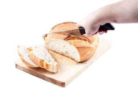 Hogaza  Spanish bread, similar to bread boule  over a kitchen cutting board isolated in a white background Stock Photo - 14505352