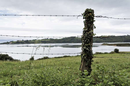 A fence near the sea in a cloudy day Stock Photo - 14606807