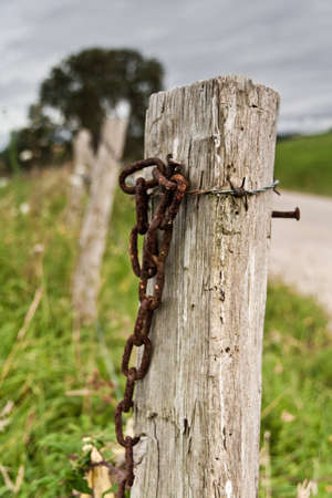A fence near a road in a very cloudy day Stock Photo - 14606803