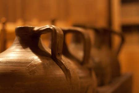 Handmade potsvases on a wooden shelf