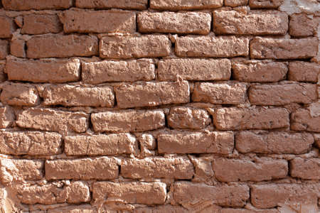 A wall made of old bricks in the countryside photo