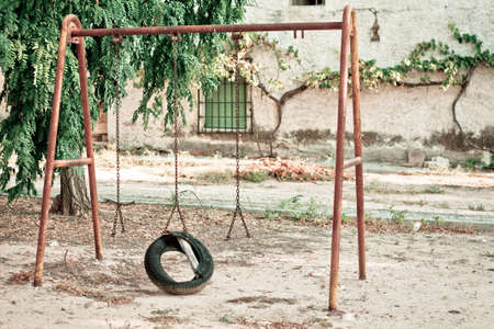 An old and lonely swing Stock Photo
