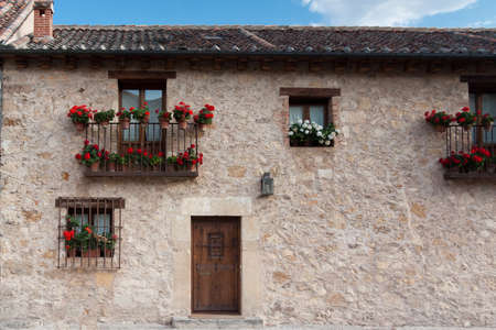 An old flowery house in Pedraza, Segovia  Spain