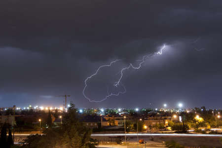 A lightning over the city of Madrid, Spain Editorial