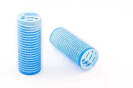 Two blue hair rollers photo