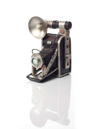 An old camera with a white background photo