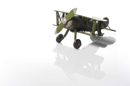 A green model of an old airplane