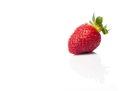 An isolated strawberry with its reflection Stock Photo - 14992357