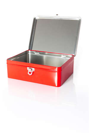 A red and open box isolated with its reflection