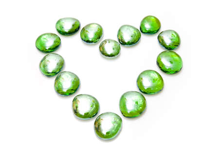 Heart made of green stones isolated in a white background