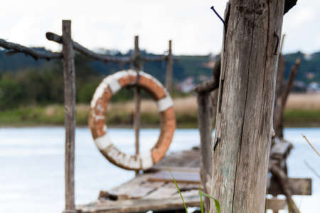 gangway: A gangway over the water with a lifebuoy at the background in Asturias  Spain
