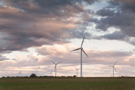 The sunset in a wind farm Stock Photo
