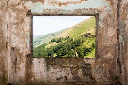 Old room and a landscape view through the window in Peaks of Europe   Picos de Europa   Vega de Pas, Cantabria  Spain  photo
