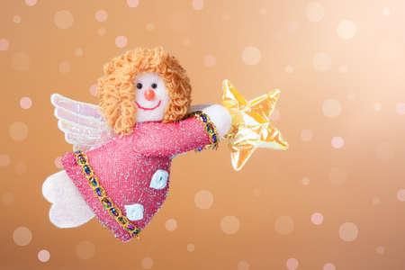 gabriel: Christmas ornament  Annunciation Angel Gabriel with a background of defocused lights