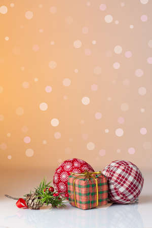 Christmas ornament  Christmas gifts in colorful wrapping with golden ribbons and christmas balls with a background of defocused lights photo