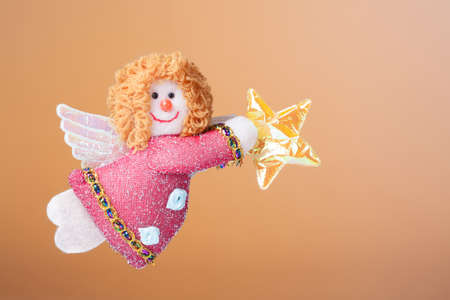angel gabriel: Christmas ornament  Annunciation Angel Gabriel with an orange background Stock Photo
