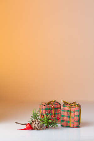 Christmas ornament  Christmas gifts in colorful wrapping with golden ribbons with an orange background