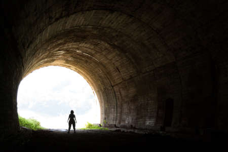 back light: Silhouette in the abandoned train tunnel of Cantabria Stock Photo