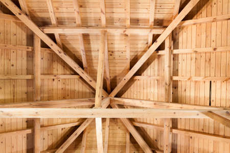 Wooden roof with main beam and joist