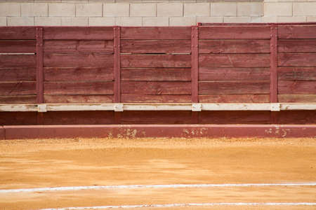 The red wall of a spanish bullring