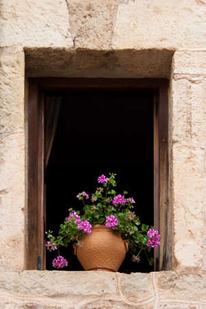 iron curtains: An old flowery window Stock Photo