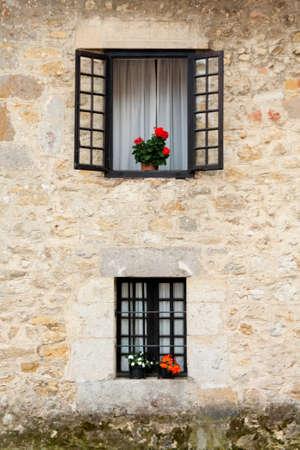 An old flowery window Stock Photo