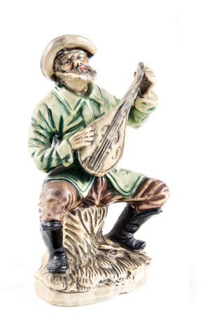 lute: Musician sculpture with a lute isolated on white background