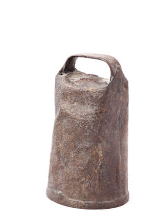 Old and rusty cowbell isolated on white background photo