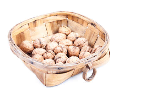 Walnut in wooden bowl isolated on white background