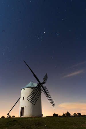 A typical windmill surrounded of stars in Castilla la Mancha, Spain photo