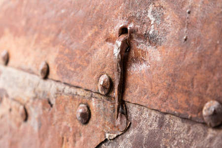Rusty metal plate with a seam and rivets for background Stock Photo