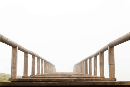 Wooden stairs in a foggy day  Lakes of Covandoga  Asturias  Spain  Stock Photo
