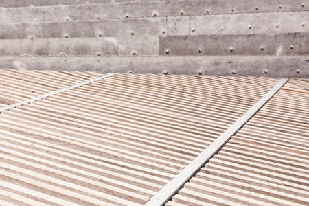 Wooden pattern floor with metal stairs at background Stock Photo