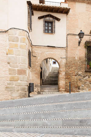 Traditional moorish doorway with stairs in Toledo, Spain