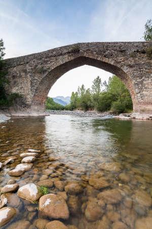 Ancient roman bridge in the north of Aragon, Spain  Valle de Hecho  Stock Photo