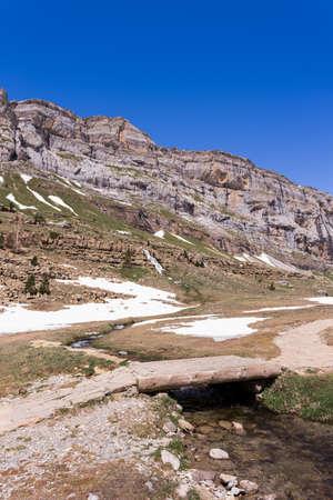 perdido: Bridge and waterfall in the spanish national park Ordesa and Monte Perdido, Pyrenees