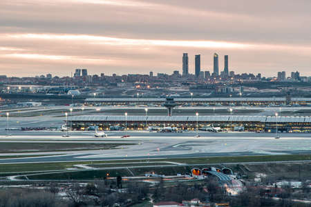 Madrid-Barajas Airport with the Four Towers Business Area at the background Stock Photo