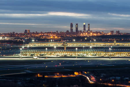 Madrid-Barajas Airport with the Four Towers Business Area at the background Banco de Imagens