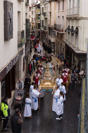 whose: TUDELA, SPAIN - APRIL 19: Festival of Regional Tourist Interest, an angel, incarnated by a child, descends from the skies until reaching the image of the Virgin, whose head is covered by a black veil as a sign of mourning for the death of her Son.
