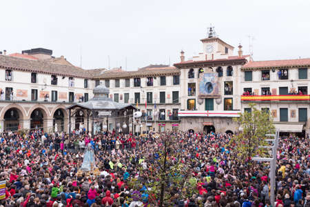 descends: TUDELA, SPAIN - APRIL 19: Festival of Regional Tourist Interest, an angel, incarnated by a child, descends from the skies until reaching the image of the Virgin, whose head is covered by a black veil as a sign of mourning for the death of her Son.