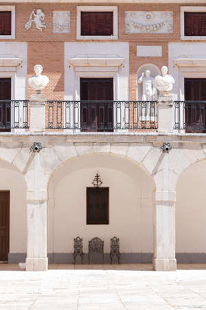 Old palace with balconies, statues and archs