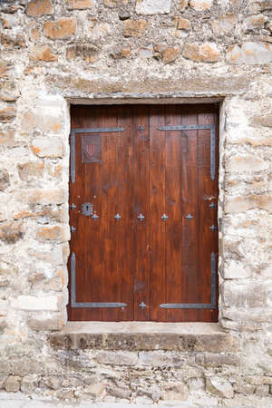 The facade of an old and rustic house in Spain