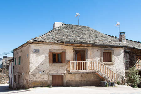 Old house in the village of Valverde de los Arroyos, one of the Black Villages Guadalajara (Spain), with the Ocejón Peak in the background Editorial