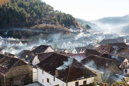 Smoking chimneys in the village of Ochagavia, Navarre (Spain)