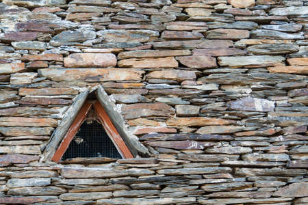 WIndow in the slate roof of an old house