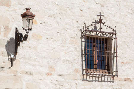 Old lamp and window on a wall