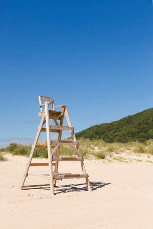 life guard stand: Baywatch chair in a beautiful beach empty at summer Stock Photo