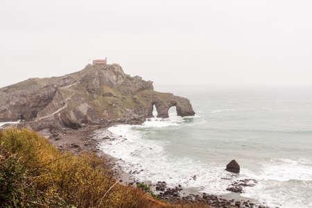 Old chapel on the cliff, by the sea. San Juan de Gaztelugatxe, Basque Country Stock Photo